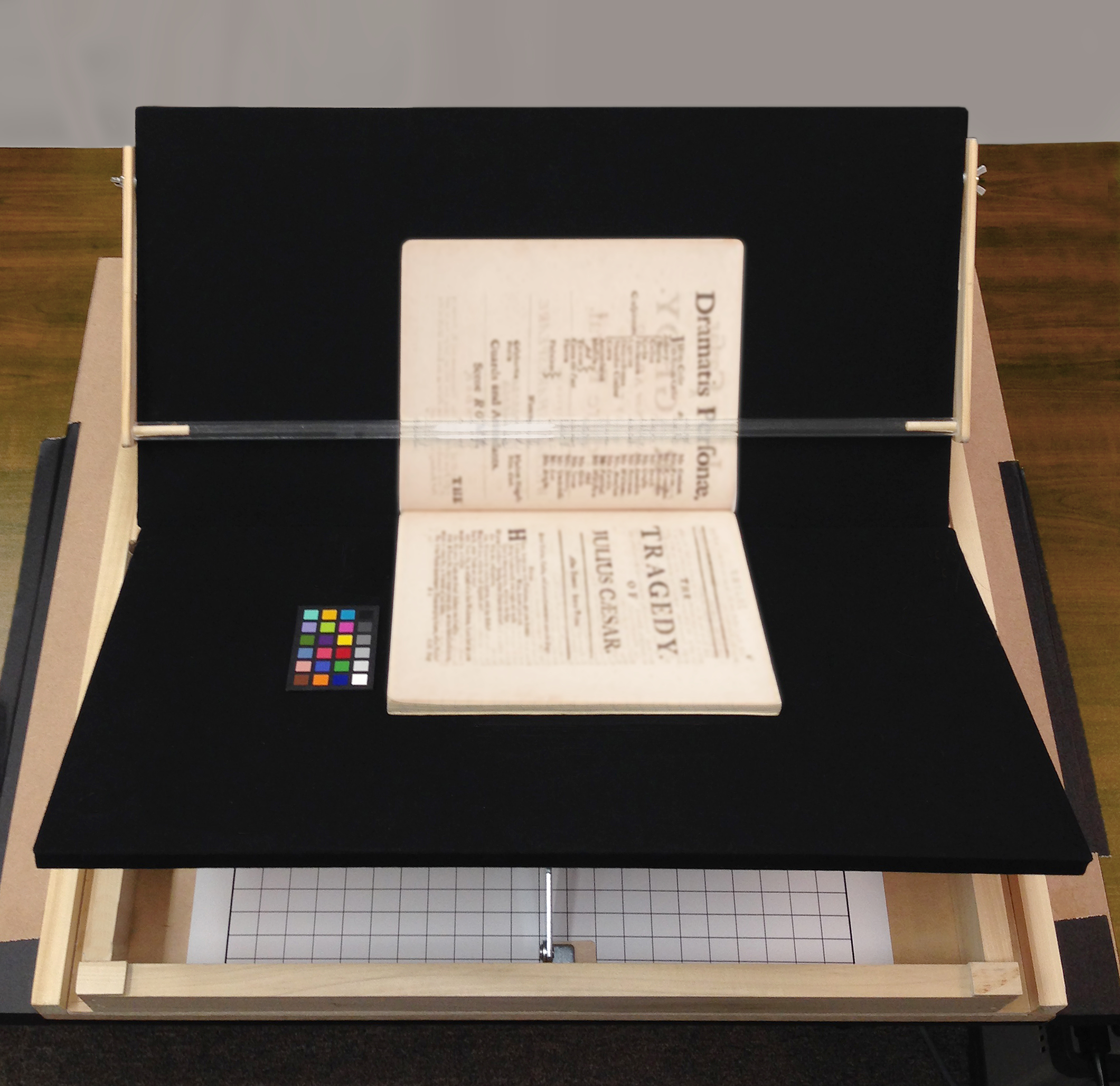 Our custom book cradle protects fragile books from undue stress.